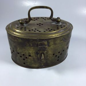 Copper colored key whole pattern oval lidded box